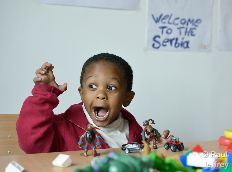 A child plays in the day care center of the Krnjaca Center for Refugees on the outskirts of Belgrade, Serbia.