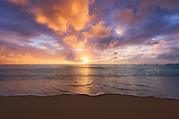Beautiful colorful sunset light illuminates the blue waters of the islands in the West indies.
