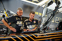 Sep 25, 2016; Madison, IL, USA; Crew chief Mike Green (left) for NHRA top fuel driver Tony Schumacher during the Midwest Nationals at Gateway Motorsports Park. Mandatory Credit: Mark J. Rebilas-USA TODAY Sports