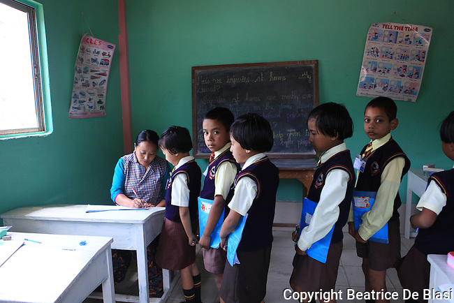 Teacher and pupils at Ambootia elementary school on the fair trade tea plantation, Darjeeling