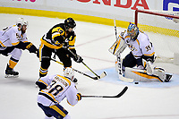 May 29, 2017: Nashville Predators goalie Pekka Rinne (35) blocks a shot by Pittsburgh Penguins left wing Chris Kunitz (14)  during game one of the National Hockey League Stanley Cup Finals between the Nashville Predators  and the Pittsburgh Penguins, held at PPG Paints Arena, in Pittsburgh, PA. Pittsburgh defeats Nashville 5-3 in regulation time.  Eric Canha/CSM