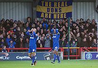 Lyle Taylor (33) of AFC Wimbledon holds his head after missing a good chance to score during the Sky Bet League 2 match between AFC Wimbledon and Wycombe Wanderers at the Cherry Red Records Stadium, Kingston, England on 21 November 2015. Photo by Alan  Stanford/PRiME.