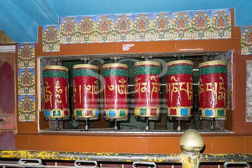 Himachal Pradesh, India. Buddhist prayer wheels in a small shrine on the road from Dharamsala to Shimla.