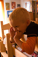 Boy age 3 intensely involved in an activity. Balucki District Lodz Central Poland