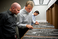 Norwegian employees of the European company StatOil, Thomas Johansen (cq, 32, far left), a completion engineer from Matrand, Lars Erik Oino (cq,44, middle), a geologist from Oslo, and Eivind Vamraak (cq, 37) a mid steam engineer, from Stavanger, interpret shale ore samples at Chesapeake Energy's headquarters in Oklahoma City, OK, Thursday, Sept., 23, 2009. Chesapeake Energy has a new program to work with foreign companies to help train on new shale technology...PHOTOS/ MATT NAGER