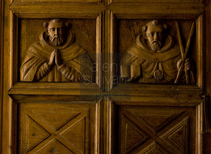 Original carved figures on a door at Iglesia La Merced in Antigua, Guatemala on Thursday, March 15, 2007.