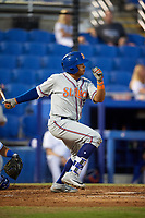 St. Lucie Mets third baseman Jhoan Urena (24) follows through on a swing during a game against the Dunedin Blue Jays on April 19, 2017 at Florida Auto Exchange Stadium in Dunedin, Florida.  Dunedin defeated St. Lucie 9-1.  (Mike Janes/Four Seam Images)