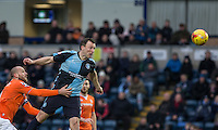 Garry Thompson of Wycombe Wanderers heads a shot at goal during the Sky Bet League 2 match between Wycombe Wanderers and Luton Town at Adams Park, High Wycombe, England on 6 February 2016. Photo by Andy Rowland.