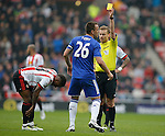 John Terry of Chelsea receives his first yellow card for a foul on Jermain Defoe of Sunderland during the Barclays Premier League match at the Stadium of Light, Sunderland. Photo credit should read: Simon Bellis/Sportimage