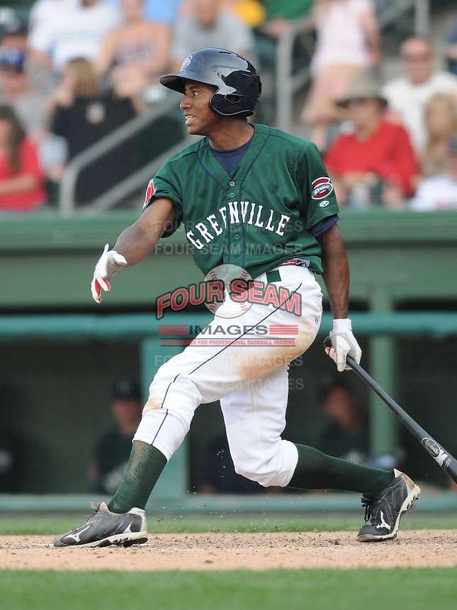 Outfielder Felix Sanchez (34) of the Greenville Drive, Class A affiliate of the Boston Red Sox, in a game against the Augusta GreenJackets on April 10, 2011, at Fluor Field at the West End in Greenville, South Carolina. (Tom Priddy / Four Seam Images)