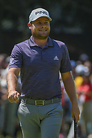 Tyrell Hatton (ENG) smiles after sinking his birdie putt on 2  during round 4 of the World Golf Championships, Mexico, Club De Golf Chapultepec, Mexico City, Mexico. 3/4/2018.<br /> Picture: Golffile | Ken Murray<br /> <br /> <br /> All photo usage must carry mandatory copyright credit (&copy; Golffile | Ken Murray)