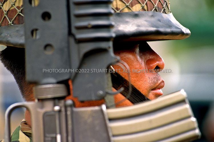 May, 1997--Aranyaprathet, Thailand.A Thai border guard watches over the Thai Cambodian border...All photographs ©2003 Stuart Isett.All rights reserved.This image may not be reproduced without expressed written permission from Stuart Isett.