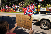 "Hillsborough, North Carolina - August 8, 2015 - Orange County Taking Back Orange County rally attendees and protestors take sides Saturday August 8, 2015 near the Hillsborough Town Hall complex in Hillsborough, North Carolina. The rally, which was prompted by the potential removal of the word ""Confederate"" from the Orange County Historical Museum, remained peaceful."
