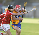 Lorcan Mc Loughlin of Cork  in action against Peter Duggan of Clare during their Munster Hurling League game at Cusack Park. Photograph by John Kelly.