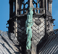 Statues of 3 of the 12 apostles and the winged bull symbol of the Evangelist Luke, at the base of the fleche or spire of Notre Dame de Paris, Ile de la Cite, Paris, France. The spire was built c. 1860 under Eugene Viollet le Duc, who was restoring the cathedral.  The cathedral itself was built 1160-1345 and was listed as a UNESCO World Heritage Property in 1991 as part of the Banks of the Seine. Picture by Manuel Cohen