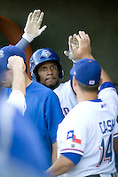 Round Rock Express outfielder Julio Borbon #20 is greeted in the dugout after scoring the first run in a game against the Memphis Redbirds at the Dell Diamond on July 7, 2011in Round Rock, Texas.  Round Rock defeated Memphis 6-4.  (Andrew Woolley / Four Seam Images)