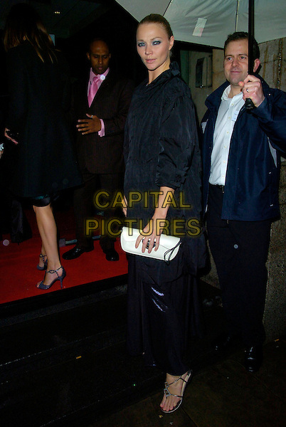 JODIE KIDD.Attend The Emeralds & Ivy Ball, Old Billingsgate Market, London, England, November 30th 2007..full length black coat clutch bag purple blue dress.CAP/CAN.©Can Nguyen/Capital Pictures