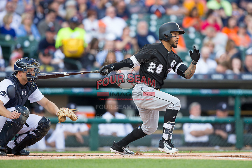 Leury Garcia (28) of the Chicago White Sox follows through on his swing against the Detroit Tigers at Comerica Park on June 2, 2017 in Detroit, Michigan.  The Tigers defeated the White Sox 15-5.  (Brian Westerholt/Four Seam Images)