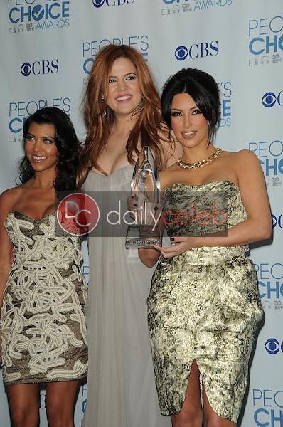 Kourtney Kardashian, Khloe Kardashian and Kim Kardashian<br /> at the 2011 People's Choice Awards - Press Room, Nokia Theatre, Los Angeles, CA. 01-05-11<br /> David Edwards/DailyCeleb.com 818-249-4998