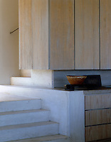 A close-up of the limed-wood kitchen units
