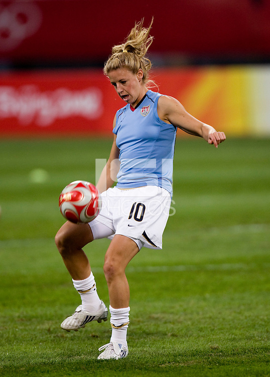 Aly Wagner. The USWNT defeated New Zealand, 4-0, during the 2008 Beijing Olympics in Shenyang, China.  With the win, the USWNT won group G and advanced to the semifinals.