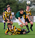 Hibs' Callum Booth is challenged by Lewis Barr.