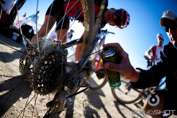 Riders are assisted during stage three of the 2010 Absa Cape Epic Mountain Bike stage race from Ceres to Ceres in the Western Cape, South Africa on the 23 March 2010.Photo by Karin Schermbrucker/SPORTZPICS