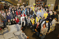 Wednesday, February 13, 2013.  49 of the musher food drop bag volunteers pose for a photo at the Airland Transport warehouse in Anchorage.Iditarod 2013