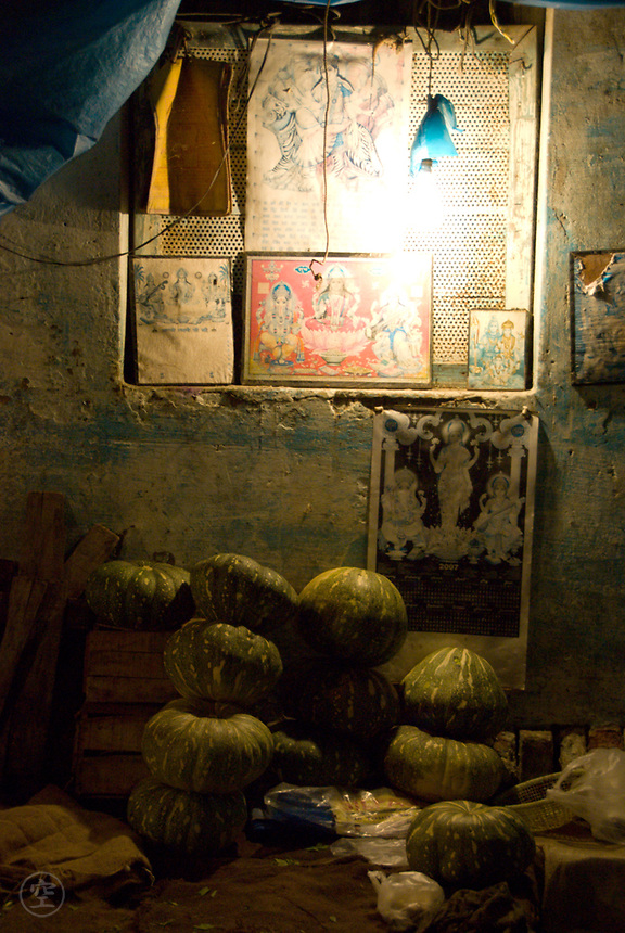 A pumpkin stall at the night vegetable market in Pahar Ganj, New Delhi, India