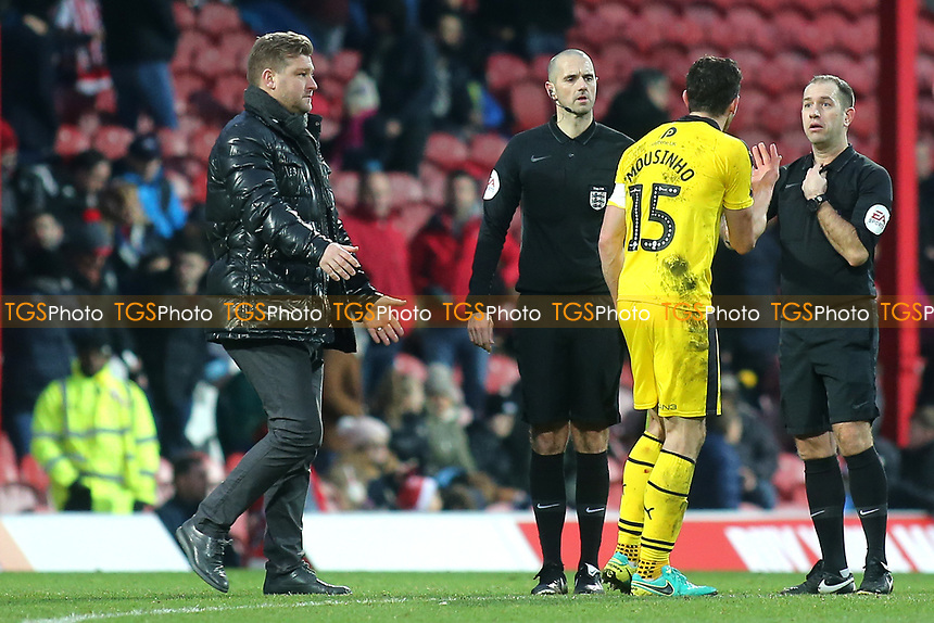 Oxford United captain, John Mousinho has a word with referee, Jeremy Simpson at half-time as Oxford Manager, Karl Robinson walks across to intervene during Brentford vs Oxford United, Emirates FA Cup Football at Griffin Park on 5th January 2019