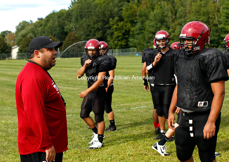 Torrington, CT- 23 August 2013-082313CM01-  Torrington football head coach Gaitan Rodriguez talks with his players during practice in Torrington Friday afternoon.  This is Rodriguez' first year as the teams coach.      Christopher Massa Republican-American