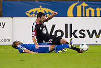 Chris Pontius (13) of D.C. United is tackled by Danny Cruz (44) of the Philadelphia Union during a Major League Soccer game at RFK Stadium in Washington, DC. D.C. United tied the Philadelphia Union, 1-1.