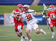 Annapolis, MD - May 20, 2018: Maryland Terrapins Roman Puglise (38) gets hit in the throat during the quarterfinal game between Maryland vs Cornell at  Navy-Marine Corps Memorial Stadium in Annapolis, MD.   (Photo by Elliott Brown/Media Images International)