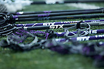 STX brand lacrosse sticks sit on the ground prior to the NCAA women's lacrosse match between the Furman Purple Paladins and the High Point Panthers at Vert Track, Soccer & Lacrosse Stadium on February 10, 2018 in High Point, North Carolina.  The Panthers defeated the Purple Paladins 17-6.  (Brian Westerholt/Sports On Film)