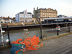 Fishing nets and boats from Ha Penny pier, Pier Hotel and Former Great Eastern Hotel in background, Harwich, Essex