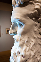 """A marble bust of abolitionist John Brown stands on a work table while conservators work on a replacement nose and eyebrow in the Tisch Family Gallery at the Tufts University Art Gallery at Tufts University in Medford, Massachusetts, on Thurs., Oct. 6, 2016. The bust was sculpted by Edward Augustus Brackett and had been improperly stored for decades with a broken nose and eyebrow. The conservators, from Rika Smith McNally and Associates, found a plaster cast made from the original at the Boston Athenæum and had a 3D modeler image the broken section of the original and the cast. They then used 3D printing technology to use to create a plaster nose replacement that would fit perfectly on the broken marble bust. They then used gouache paint to match the replacement pieces to the original marble.  The bust is part of an exhibition at the gallery entitled """"Mortal Things: Portraits Look Back and Forth."""""""