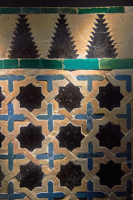14th century Zellige tile panel from the Reala Alcazar of Seville in the time of Peter I of Castile. Seville Alcazar Museum, Seville.
