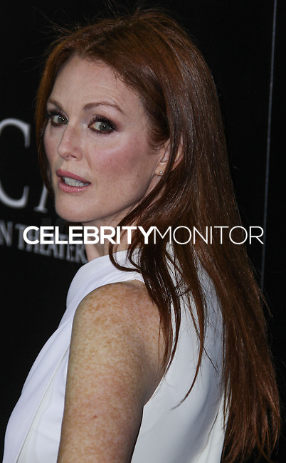 """HOLLYWOOD, CA - OCTOBER 07: Actress Julianne Moore arrives at the Premiere Of Metro-Goldwyn-Mayer Pictures & Screen Gems' """"Carrie"""" held at ArcLight Cinemas on October 7, 2013 in Hollywood, California. (Photo by Xavier Collin/Celebrity Monitor)"""