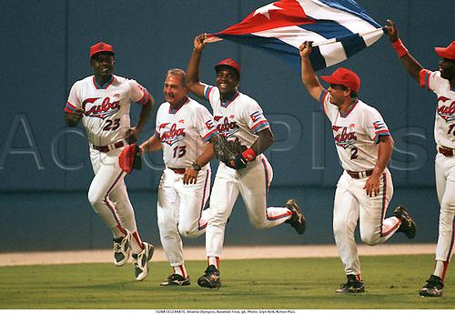 CUBA CELEBRATE, Atlanta Olympics, Baseball Final, 96. Photo: Glyn Kirk/Action Plus....celebrations.celebration.celebrates.olympic games.joy.celebrating.flags.winning.1996