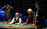"""Hevad """"Rain"""" Kahn holds his head as he is all in.  He doubled up."""