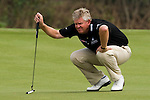 HAIKOU, CHINA - OCTOBER 31:  Colin Montgomerie of Scotland lines up a putt on the 8th green during day five of the Mission Hills Start Trophy at Mission Hills Resort on October 31, 2010 in Haikou, China.  The Mission Hills Star Trophy is Asia's leading leisure liflestyle event and features Hollywood celebrities and international golf stars. Photo by Victor Fraile / The Power of Sport Images