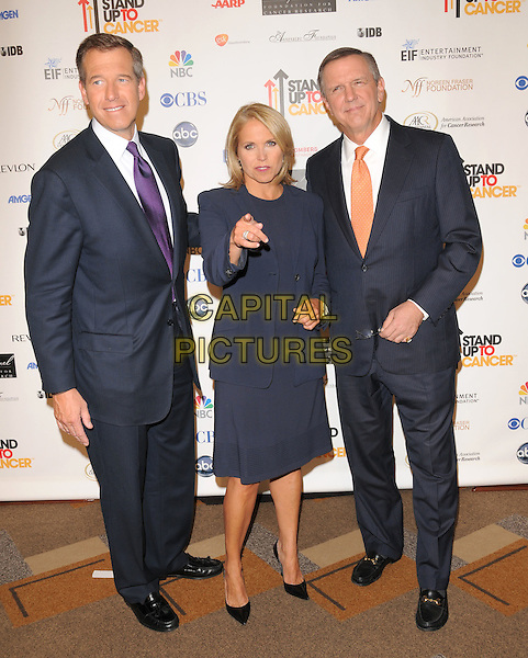 BRIAN WILLIAMS, KATIE COURIC & CHARLES GIBSON .Attending Stand Up To Cancer held at The Kodak Theatre in Hollywood, California, USA, September 05 2008.                                                                     .full length black suit jacket dress blue shoes black pointy ties suits .CAP/DVS.©Debbie VanStory/Capital Pictures