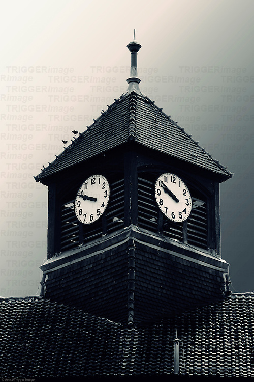 The surreal photograph of a church tower in the dark.
