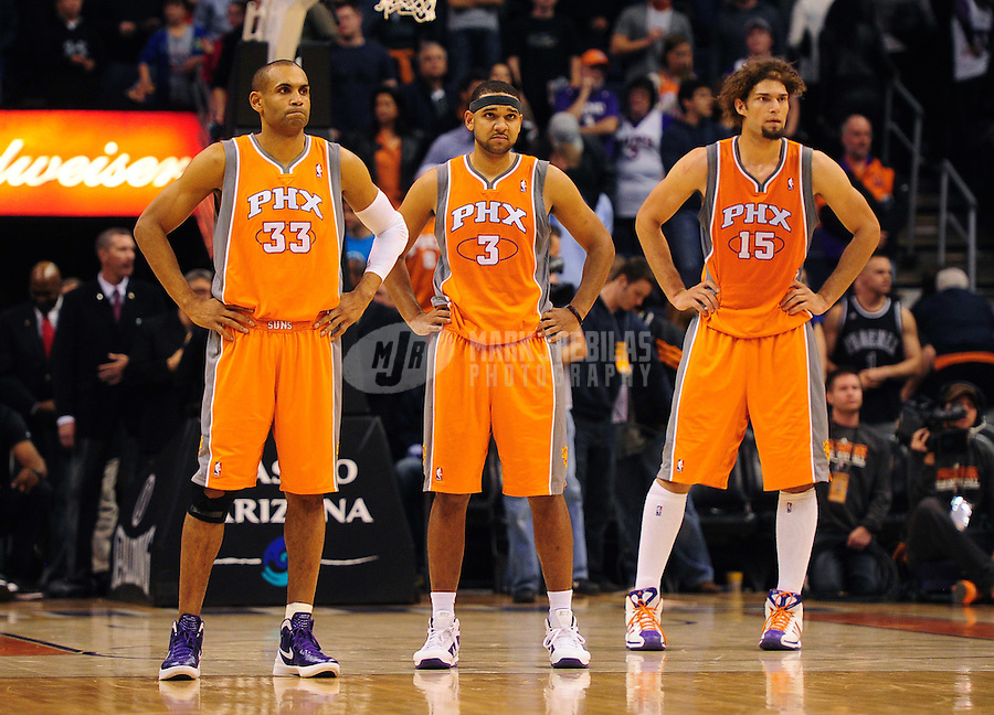 Dec. 26, 2011; Phoenix, AZ, USA; Phoenix Suns teammates (left to right) Grant Hill , Jared Dudley and Robin Lopez during game against the New Orleans Hornets at the US Airways Center. The Hornets defeated the Suns 85-84. Mandatory Credit: Mark J. Rebilas-USA TODAY Sports