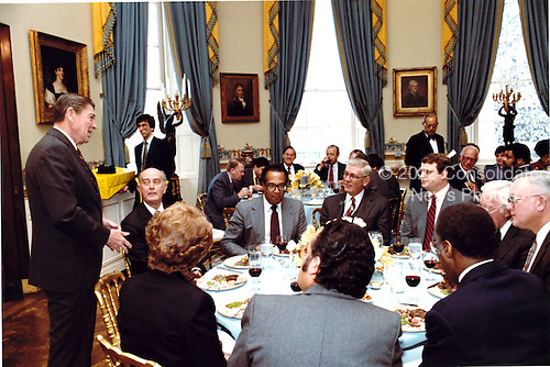 United States President Ronald Reagan addresses a working luncheon held in the Blue Room on Thursday, January 21, 1982 on the Enterprise Zone Program.  Present at the head table from the President's left: Mayor Donald Schaefer of Baltimore, Maryland; U.S. Secretary of Housing and Urban Development Samuel Pierce; Howard Scaggs, President of American National Building and Loan, Baltimore, MD; Rich Williamson, Assistant to the President for Intergovernmental Affairs; William Verity, Chairman of the Presidential Task Force on Private Sector Initiatives; Jack Mosley, CEO of U.S. Fidelity and Guarantee, Baltimore, MD; Virgil Brown, County Commissioner of Cuyahoga County, Ohio; Henry Butta, CEO of Chesapeake and Potomac Telephone, Baltimore, MD; Mayor Margaret Hance of Phoenix, Arizona..Mandatory Credit: Jack Kightlinger - White House via CNP