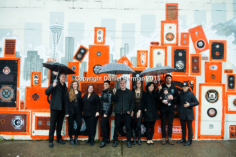 Portraits of supporters and development team at KEXP 90.3 FM in front of the mural by Painter Jonathan Wakuda Fischer at the radio station's former headquarters for more than 10 years in Seattle.