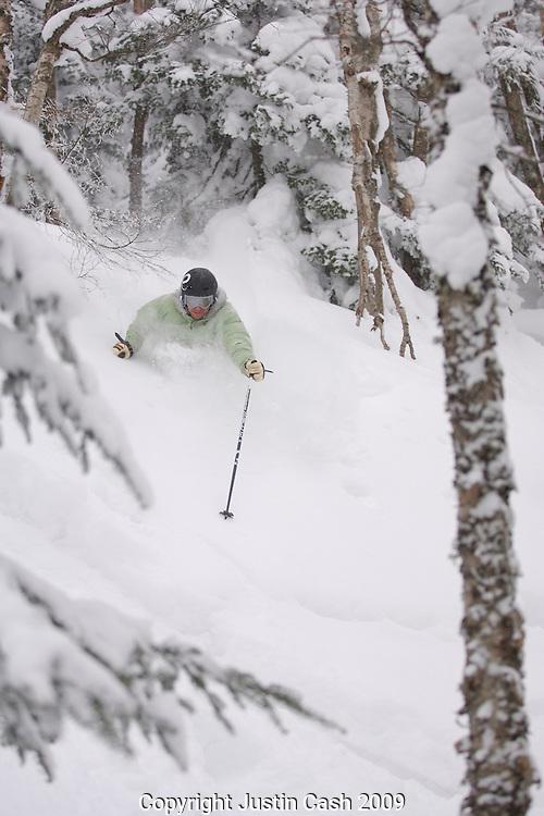 Skiers enjoying deep Vermont powder, Jay Peak, Vermont