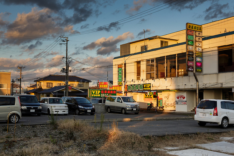 Onahama, Iwaki city, Fukushima prefecture, December 8 2014 - At VIP Room, a Soapland (japanese brothel where males receive full massages), 60 km from the crippled Fukushima Daiichi nuclear power plant. The business of soaplands in Onahama stayed stable after the 2011 disaster, as the growth of workers at the plant counterbalanced the former clients who flew to other prefectures.