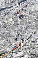 Competitors take part into the 2009 Quebec Carnival canoe on ice race across the St-Lawrence River between Quebec City and Levis February 8 2009. The Canoe Race, one of the highlights of the Carnaval de Quebec, has been held since the first edition of the Carnival