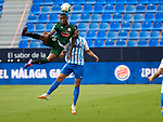 Claudio Beauvue (RC Deportivo de la Coruna) and Juande (Malaga CF) competes for the ball during La Liga Smartbank match round 39 between Malaga CF and RC Deportivo de la Coruna at La Rosaleda Stadium in Malaga, Spain, as the season resumed following a three-month absence due to the novel coronavirus COVID-19 pandemic. Jul 03, 2020. (ALTERPHOTOS/Manu R.B.)